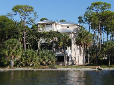 Photo for CAPTURE BEAUTIFUL SUNSETS while vacationing in this waterfront home overlooking Apalachicola Bay