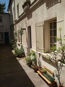Photo for '' Heart'' GREEN AREA (St Jacques) very quiet, small property, flowery courtyard.