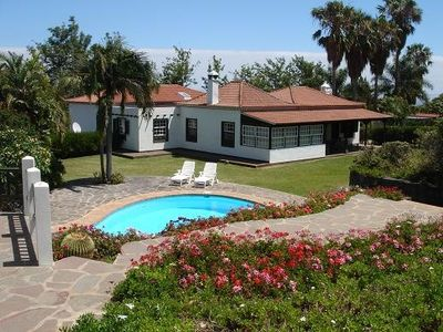Photo for Beautiful villa in exclusive 5,000m2 botanical garden with private heated pool