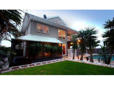 Photo for Three levels of beachfront living, 6 bedrooms, pool and beautiful views!