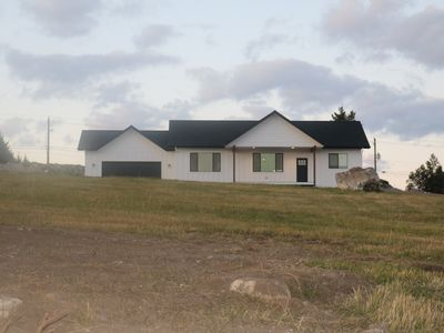 Photo for Brand new house with deck and amazing views on large country lot close to town.