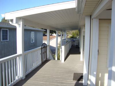 New covered side and rear deck with new stairway.