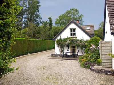 Photo for Detached cottage in the grounds of the owner's house with patio and nearby wood about a mile f…