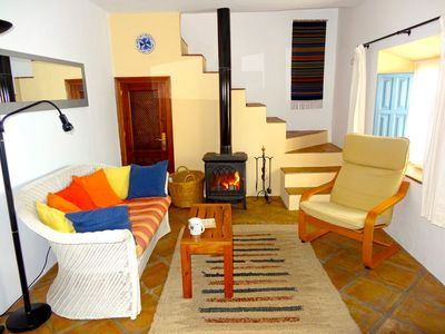 Cosy sitting room with wood burning stove.