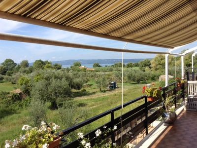 Photo for Well appointed apartment with sun terrace and Lake Bolsena view