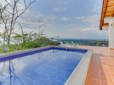 Photo for Hilltop home w/ pool, wrap-around deck & amazing ocean view - near beaches!