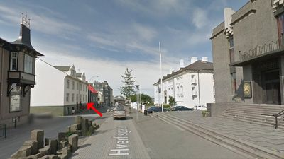 Street view. Apartment on the left and the National Theater and The Culture Hous