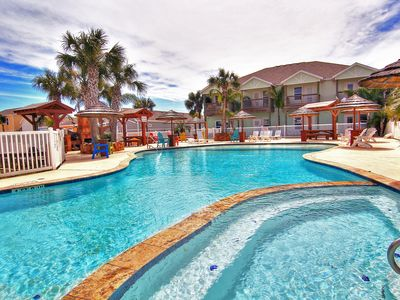 Photo for Parrotdise At Pirates Bay, New 3 bedroom townhome, amazing pool areas!