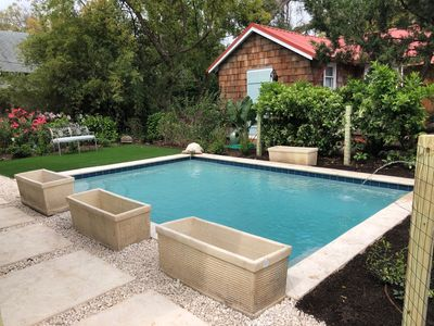 Pool measures 12x18 with a shallow end and 5.5 foot deep end.  Pool can be heated for a fee.