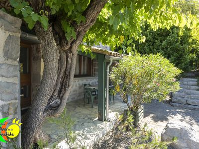 Photo for Small renovated stone cottage with pool in gites village