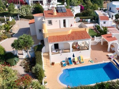 Photo for 4 Bed Villa. Heated Pool, AirCon, Free Wifi, Tennis Court. 10 min walk to beach.