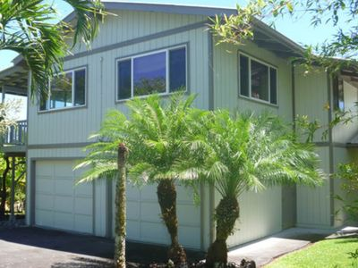 Photo for Breezy, updated home w/ lava rock lanai - 1 block to the ocean!