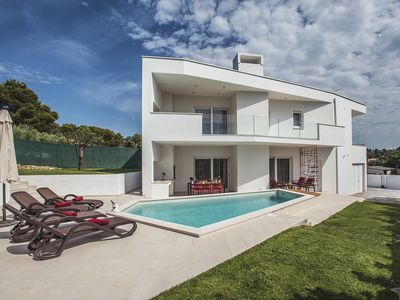 Photo for Modern villa with private pool, 2 bedrooms, 3 bathrooms, air conditioning, WiFi, table football, whirlpool and only 1.5 km to the beach