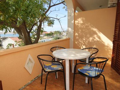 Photo for Two bedroom apartment with terrace and sea view Vidalići, Pag (A-9382-b)