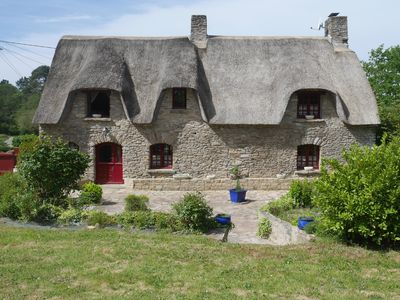 Photo for Traditional breton cottage near beach in huge fenced park for total privacy