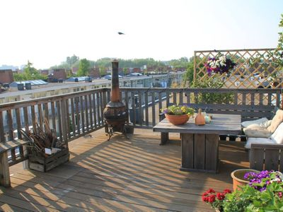 Photo for Sunny apartment + rooftop terrace near city center