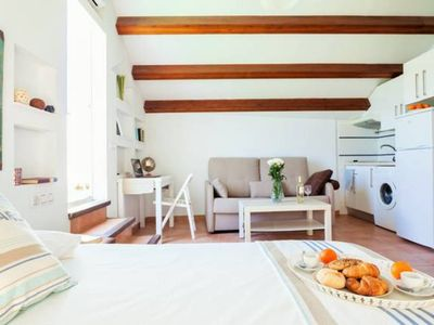 Photo for Sierpes cozy attic. Private terrace with Giralda views