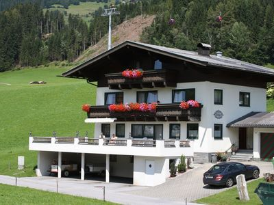 Photo for Lovely apartment right by the lift for the Kitzbüheler Ski and hiking resort.
