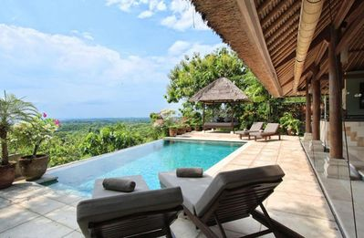 Photo for Bayu, luxury 4 bed villa, car + driver, magnificent ocean views, Uluwatu