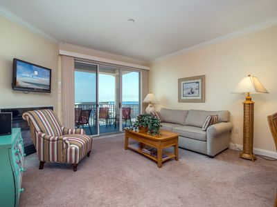 Photo for Newer construction beautiful condo right on the boardwalk with a pool!