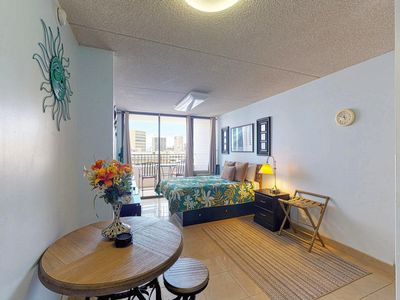 Photo for Bright condo in Waikiki w/ shared pool, sauna, tennis & gym - free parking!