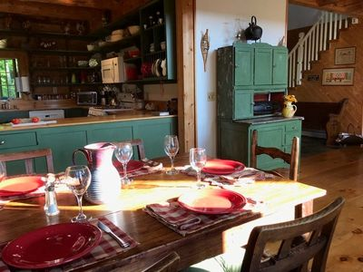 The antique dining table can seat up to eight hungry visitors.