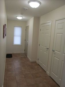 The entry and closet are large enough to accommodate several people
