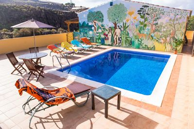 private Heated swimming pool on 100 sq m. terrace with dining table and seating.