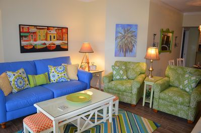 The living area with a beachy vibe is a great place to hang out and watch a NetFlix movie on the new LED TV!