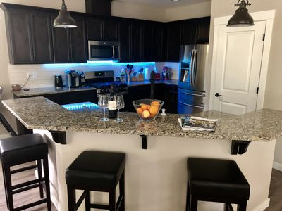 Fully equipped kitchen with bar style island. Lots of appliances.