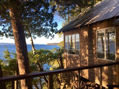 Photo for Lake Champlain camp, spacious deck, sunset & mountain views, beach and dock