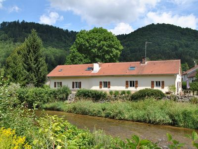 Photo for Ground floor of a renovated farmhouse on the banks of the Moselotte.