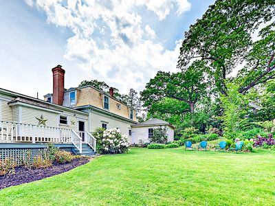 Backyard - The house sits on 3/4 acre of lawn, gardens and trees, bordered on 3 sides by tall cedars.
