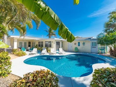 Barefoot Bliss:Coastal Living,Tropical Setting,Heated Pool,Short Stroll to Beach