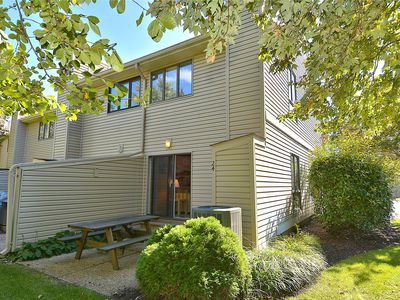 Photo for FREE ACTIVITIES INCLUDED!  End unit with 2 bedrooms, 1.5 bath townhouse with central air conditioning, full kitchen, includes microwave, dishwasher, washer/dryer.  Units have a spiral staircase,