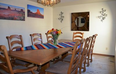 Long dining room table comfortably seats 8.