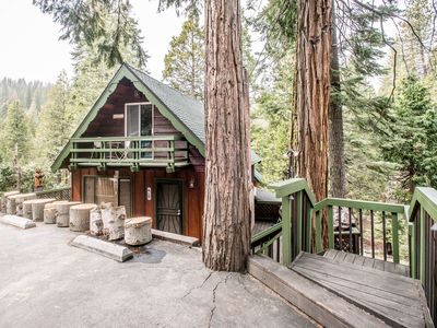 Photo for A classic forest cabin with modern amenities - the best of both worlds!