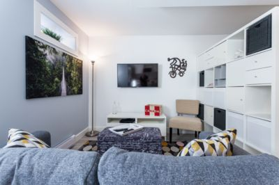 """living room. 40"""" ultra high def TV with netflix and cable."""