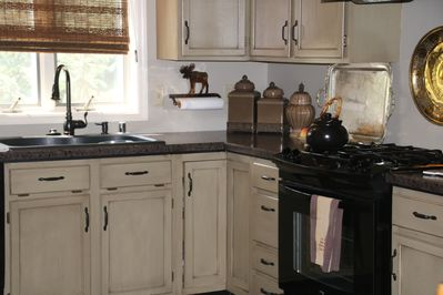Beautiful kitchen with Gas range and well furnished for entertaining.