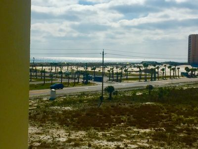 Photo for 2 min walk to the beach,beautiful views of ocean and bay from condo, bar's close