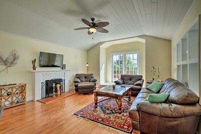 Relax in the bright living room, highlighted by tall ceilings and natural light.