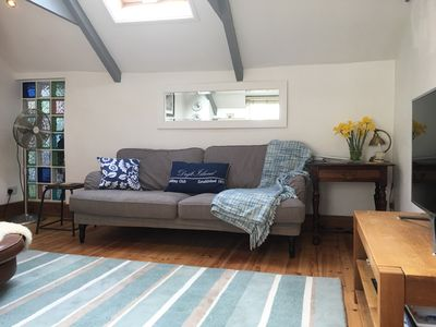 One of two comfy sofas with skylight