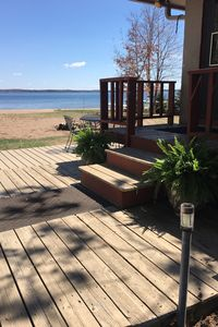 Photo for Shell Lake cabin with awesome sandy beach & spectacular view!