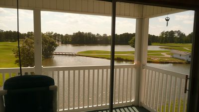 Evening lake and golf course views from inside living room.