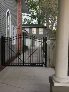 Graceful wrought-iron gated courtyard entryway