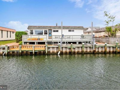 Photo for Awesome 4BR Waterfront Home, Walk to Beach, Dock, 1900 sq. ft of fun!