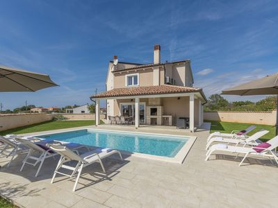 Photo for Stylish Villa with pool and fenced garden,ideal for relaxing family holidays