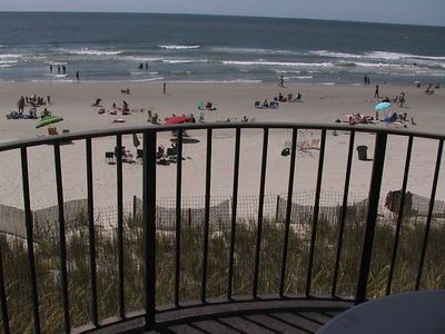 From the balcony-large table-4 chairs and a chaise chair/Large uncrowded beach
