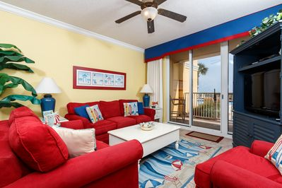 Our sunny living room just makes you feel happy to be at the beach!
