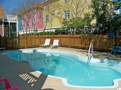 Photo for Come relax at an upscale duplex with pool nestled between mature live oaks